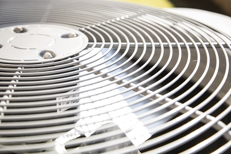 How Does an Air Conditioner Work? Top view of an air conditioner unit outdoors in hot summer season. No people.